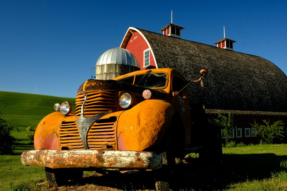 truck and red barn